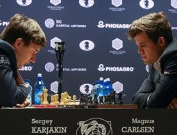 Карякин и Карлсен сыграли вничью в 12-й партии матча за шахматную корону